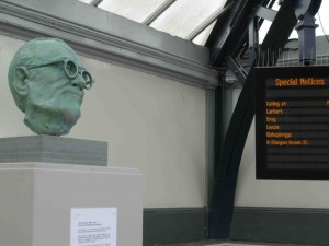 A bust of John Grierson by the sculptor Kenny Munro at Stirling Train Station.