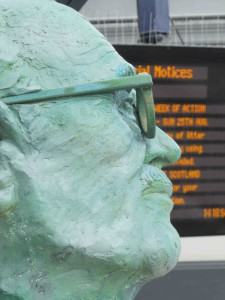 Detail of bust of John Grierson by the sculptor Kenny Munro at Stirling Train Station.