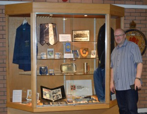 Our Exhibition Assistant, Ian Mackintosh, with the display of material from Sir Peter Heatly's collection he created for the exhibition in the Dewars Centre, Perth.