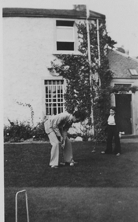 Norman McLaren and Helen Biggar playing croquet at McLaren's home in Stirling c 1936.